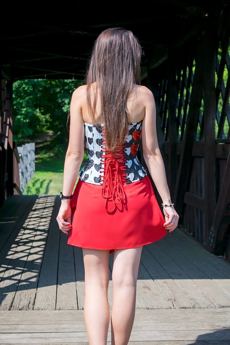 Stella wearing a black and white heart corset